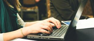 How to Write a Business Blog Article - woman typing