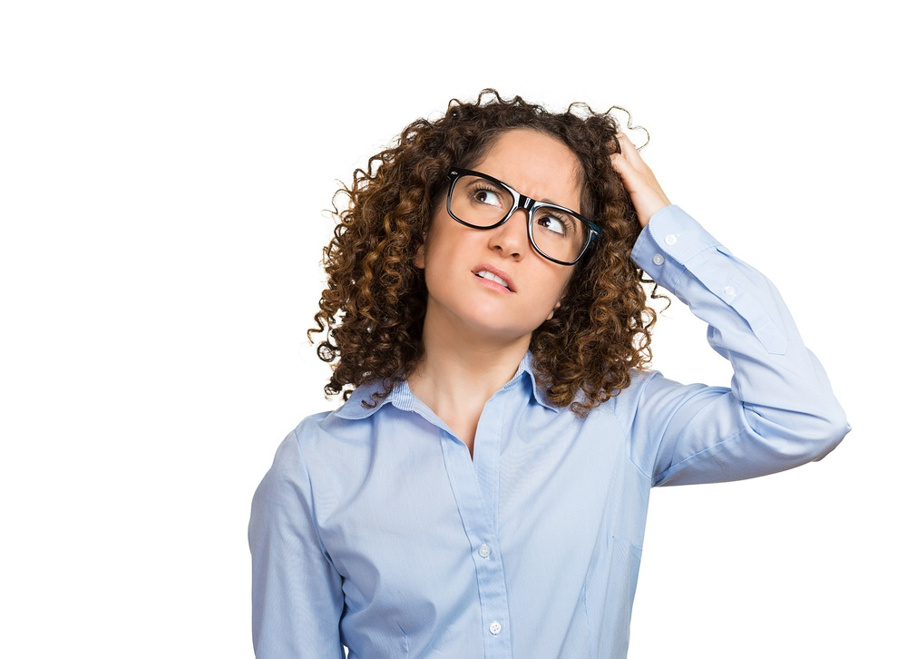 Closeup portrait young woman with glasses scratching head, thinking daydreaming deeply about something, looking up, isolated white background. Human facial expression emotions, feelings, body language.jpeg