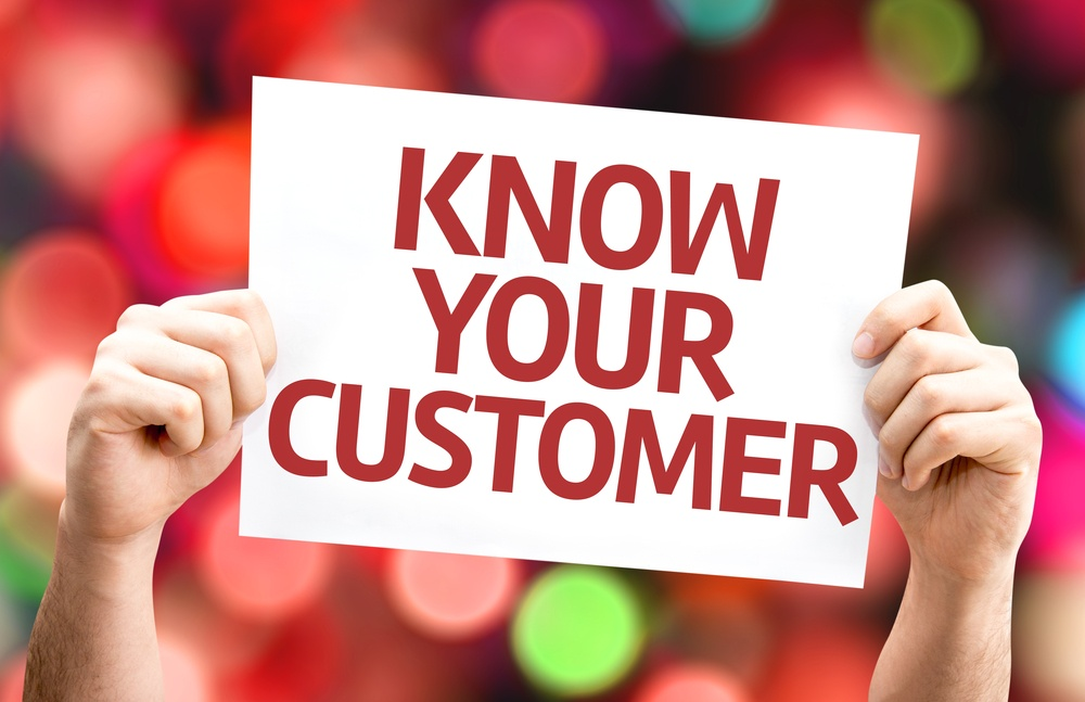 Know Your Customer card with colorful background with defocused lights.jpeg