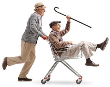 b2b customer acquisition cost - pushing man in shopping cart